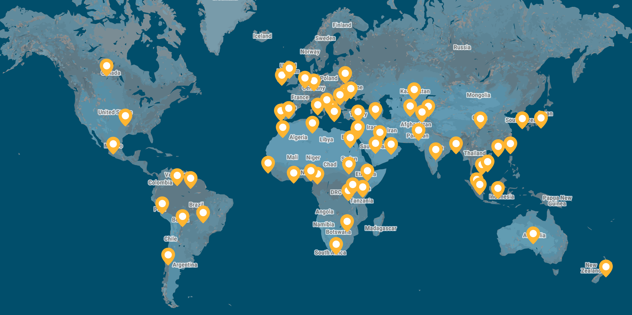 A map of the world showing 2020 Technovation Submissions. The map is dark blue with yellow pins, each pin indicating a country where at least one team created technology for social good.
